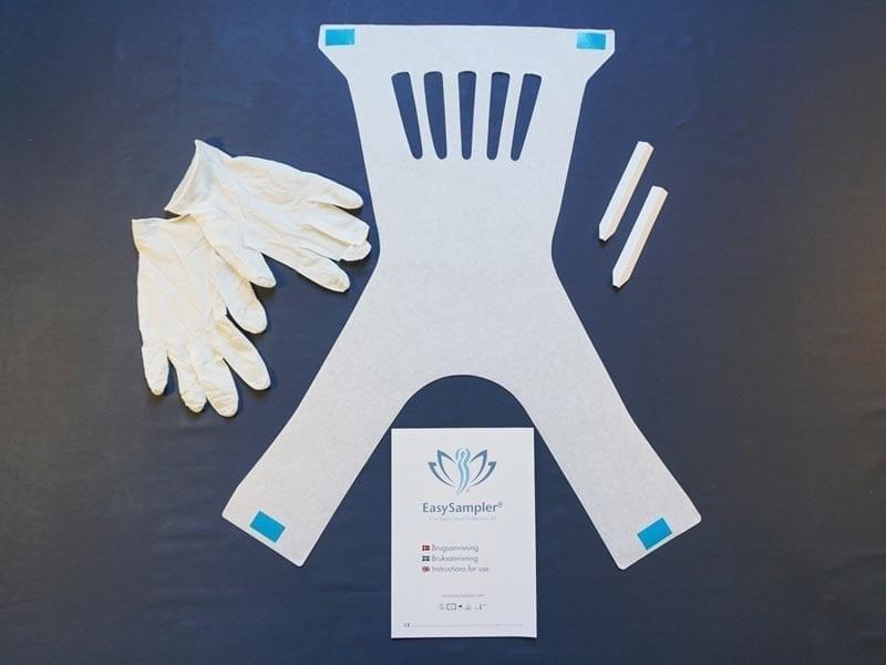 Mini kit til opsamling af afføring. Indeholder handsker, piktogram-guide og papirske for større opsamling